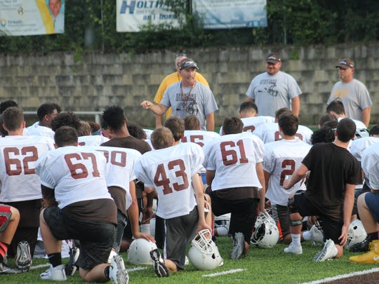 Roger Bacon coach Mike Blaut addresses his troops at