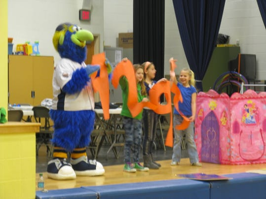 DownTown and Wrightsville Elementary students show the number of books that students read as part of Boomer's Book Club. (Photo submitted by Darrell Henry)