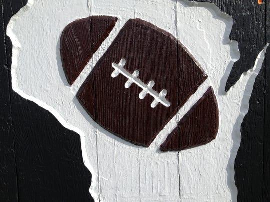 FOOTBALL-Sign