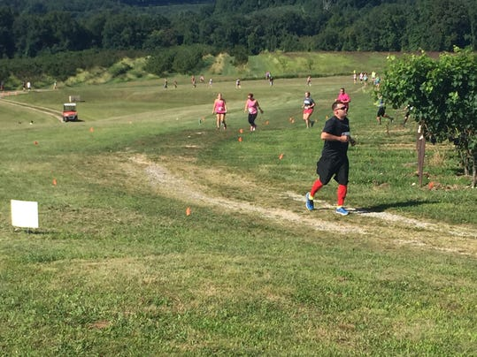 Runners make their way around the Hard Cider Run 5K at the Hauser Estate Winery just outside of Gettysburg Saturday morning.