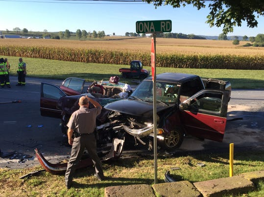 South Lebanon Township Police Chief Michael Lesher investigates a two-vehicle crash that occurred on Route 897 at the Iona Road split shortly after 7:30 a.m. Tuesday. Both drivers were injured.