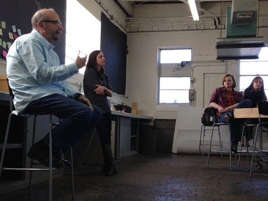 David Kelley talks to York College's Graham Innovation Scholars on Friday during a private lecture at Rudy Art Glass' Maker Space in York. Kelley, a Stanford professor and best-selling author, is founder of IDEO, one of the world's leading innovation and design firms. Kelley's progressive education concept, known as design thinking, is being modeled at York College. Erin Casey, co-owner of Rudy Art Glass, is to the right of Kelley.