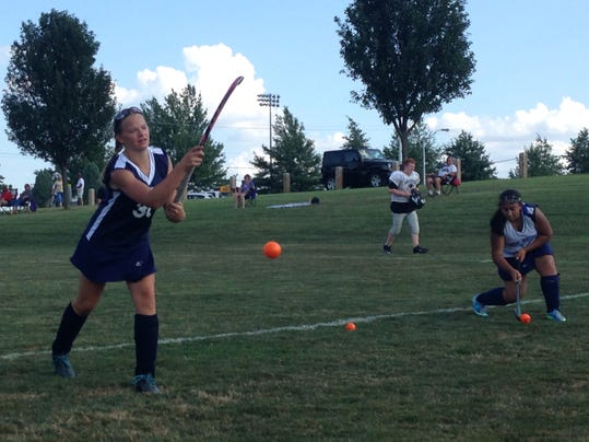 New Oxford field hockey players warm up before their 4-2 win against South Western on Tuesday.