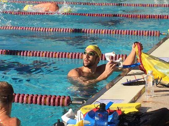 Michael Phelps pauses during a workout Monday, Jan. 11, 2016, at Arizona State in Tempe, Ariz.  Phelps moved to suburban Phoenix a few months ago after Bob Bowman, basically the only coach he's ever had, took a job running Arizona State's promising but underachieving swim program.  (AP Photo/Paul Newberry)