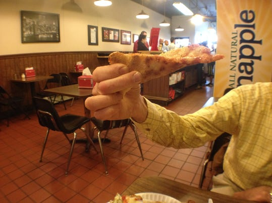 Dave Chapus hand demonstrating the proper way to hold a thin crust slice.JPG