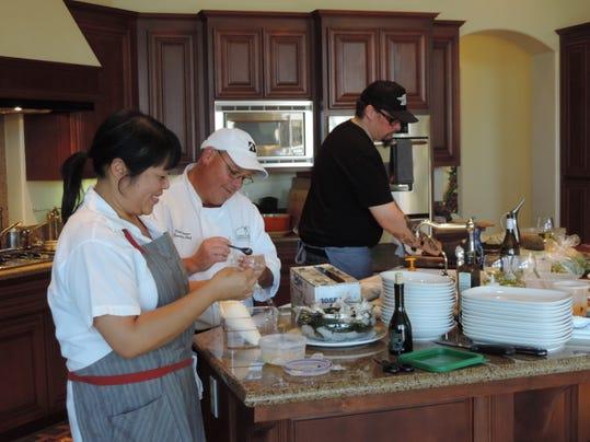 Michelle Lee, Kirk Larsen and Cy Yontz prepping for dinner.JPG