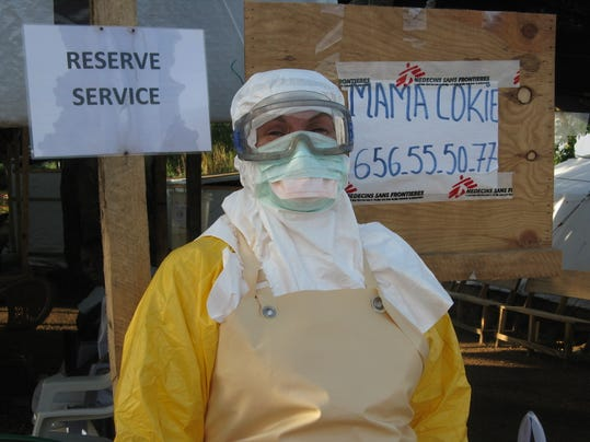 In this undated handout photo provided by Medecins Sans Frontieres, Cokie van der Velde, a British sanitation specialist for Doctors Without Borders is seen in head-to-toe protective gear in Guekedou, Guinea. Normally, she spends her days in Yorkshire, tending to her garden and looking after her grandchildren. Van der Velde has worked on two previous Ebola outbreaks _ she gets paid a salary and stipend _ and says she does this kind of work because she believes in justice and equality. She said the need is overwhelming in this outbreak because of the heavy toll Ebola has taken on health workers; many of those sickened and killed have been doctors and nurses. That has sparked fear among many local staffers and led to strikes and resignations. (AP Photo/MSF)