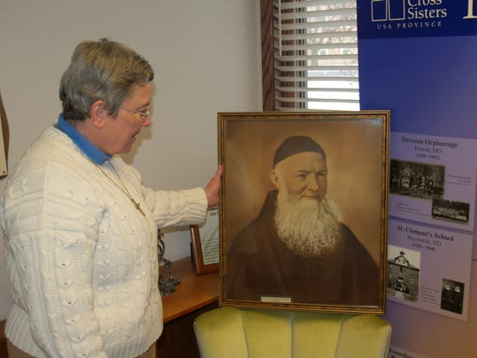 Sister Pat Cormack with picture of Father Theodosius.JPG