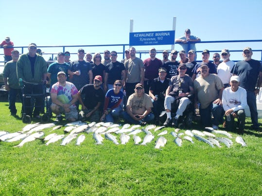 Fishing volunteers give 45 vets a day on the lake for Take a vet fishing