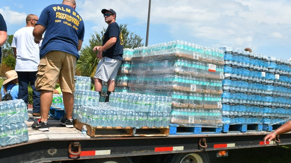 The United Way of Brevard and City of Palm Bay distributed  15 pallets of free water on Thursday in front of City Hall. The leftover water will be inside the front City Hall annex during regular business hours with a limit of two cases per family. Although Palm Bay has not lost water, the power outages make those with wells unable to pump water.