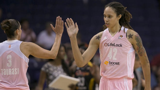 Brittney Griner, left, high-fives teammate Diana Taurasi during a win in 2013. Griner married Glory Johnson on Friday.