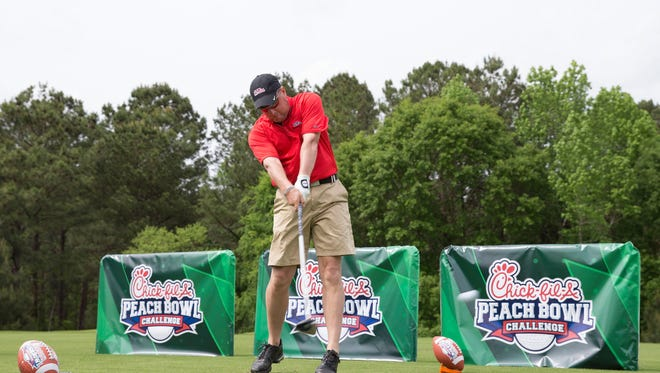 Coach Hugh Freeze displays his golf driving skills during the 2015 Chick-fil-A Peach Bowl Celebrity Challenge at Reynolds Plantation on Monday, April 27, 2015. (Chick-fil-A Peach Bowl/Abell Images/Paul Abell)