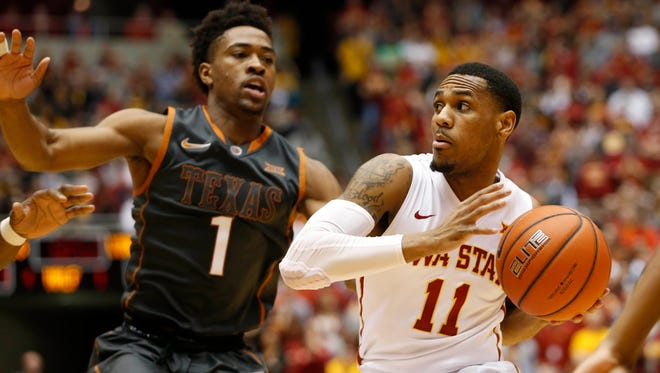 Iowa State guard Monte Morris (11) passes inside as Texas guard Isaiah Taylor (1) defends Saturday, Feb. 13, 2016, at Hilton Coliseum in Ames.