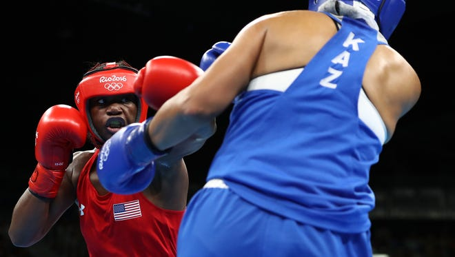 Flint's Claressa Shields, left, goes for gold Sunday in the women's middleweight boxing division.