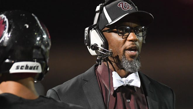 Harvest Prep coach Milan Smith looks on against Berne Union during the teams' game Oct. 5, 2018, at Harvest Prep.