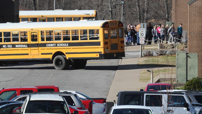 Students at Marshall County High School, in Benton, Kentucky, return from a school walkout on Wednesday morning.  A student gunman killed two students at the school in January.March 14, 2018