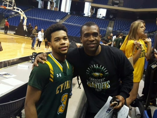 UL basketball commit Trajan Wesley, left, poses with