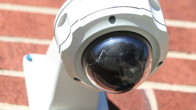 A security camera is outside the entrance to the Moxie theater.