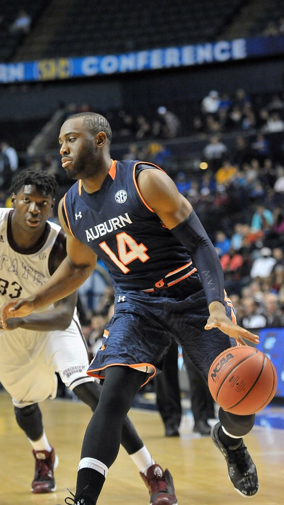 Auburn Tigers guard Antoine Mason honored his late father, Anthony Mason, in his return to the court Wednesday.