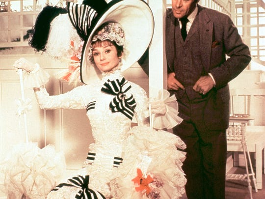 Who was the fairest of them all?  Audrey Hepburn makes a spectacle  of herself with Rex Harrison at the horse track in My Fair Lady. (l-r) Audrey Hepburn and Rex Harrison in My Fair Lady.