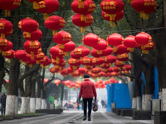 ]This street is decorated with red lanterns ahead of