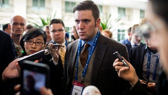 Richard Spencer talks to the media at the 44th Annual Conservative Political Action Conference.