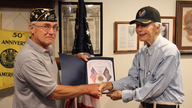 Bill Daniels, right, was honored for 65 years as a member of the American Legion. Presenting the honor is post commander Bob Borszich of the Hawley-Dieckhoff American Legion Post 33 of Neenah.