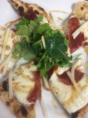 Chef Shawn Calley's prosciutto flatbread takes on the flavors of fall with apples and a cider reduction.