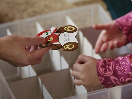 Keep ornaments safe from rodents in plastic bins, not