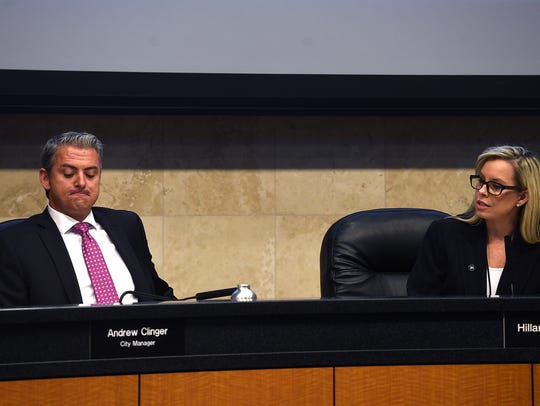 City Manager Andrew Clinger, left, listens as Mayor