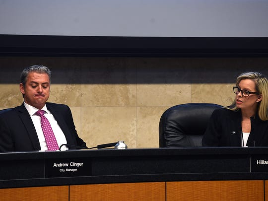 City Manager Andrew Clinger, left, listens as Mayor Hillary Schieve  speaks during a special Reno City Council meeting with regards to the sexual harassment allegations directed at City Manager Andrew Clinger on Aug. 4, 2016.