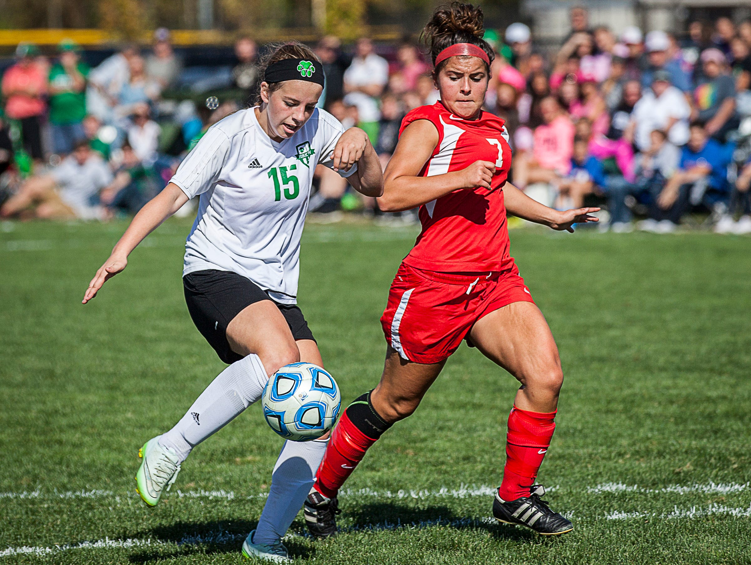 Yorktown's Sarah Wilhoite dribbles past Jay County's Gabbie Mann during their game at the Yorktown Sports Park on Saturday, Oct. 10, 2015.