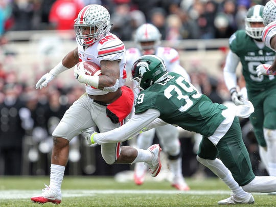 Ohio State Buckeyes running back Mike Weber (25) carries