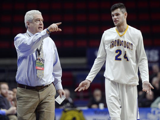 Irondequoit head coach Chris Cardon, left, talks to Jeremiah Zitz during the NYSPHSAA Boys Basketball Championships Class A semifinal in Binghamton, N.Y. on Saturday, March 18, 2017. Irondequoit advanced to the Class A championship game with a 68-56 win over Jamesville-Dewitt-III.