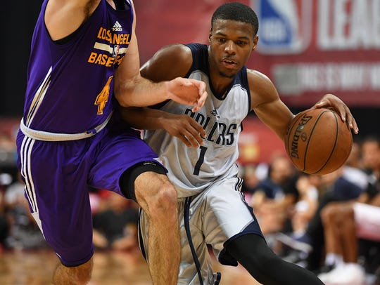 Mavericks rookie guard Dennis Smith Jr. tries to get