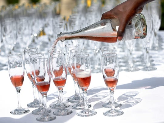 A 2015 IndyStar file photo of wine being poured into glasses.