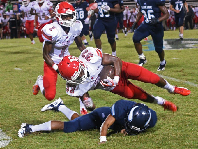 Ruston's Kevin Chatman carries the ball in their Friday
