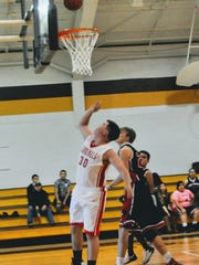 Junior Cabel Cox with layup for the Cardinals.