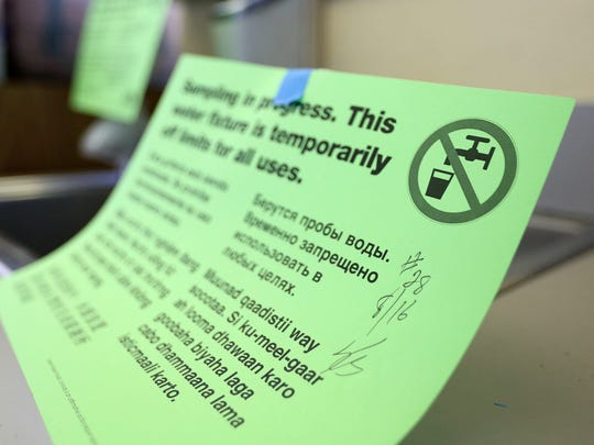 Some taps at Pringle Elementary School in South Salem are wrapped in plastic and covered in signs warning users they are off limits after testing revealed high lead levels.