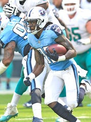 Titans cornerback Tye Smith (33) grabs an interception
