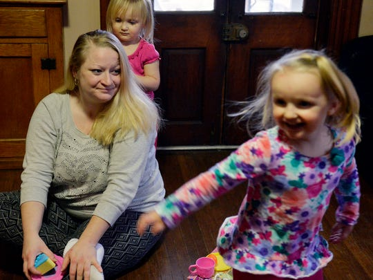 Melissa Rosenberry watches her older daughter Cassandra, 3, twirl around as her younger daughter Arabella, 2, combs her hair with a doll brush in their Hanover home in January. Rosenberry was denied a temporary protection from abuse order in 2014 against her husband, who she said raped her. Her husband denied the allegations. Rosenberry went back to court to apply for a final PFA, which was granted.