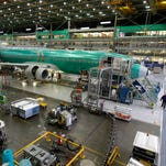 In this Dec. 16, 2014 file photo, Boeing 737-800 airplanes are on the assembly line at Boeing's 737 assembly facility in Renton, Wash.