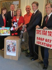 Taylor & Modeen Funeral Home kicks off its 20th annual Toys for Tots campaign. From left are Grace Carpenter, funeral assistant; Rick Waites, LFD;Carol Taylor Block, President and LFD; William J. Taylor, President Emeritus; J. Michael Taylor, FDIC; James Taylor, Funeral Assistant.