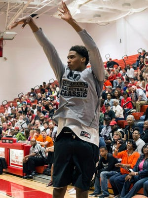 UofL recruit and Trinity High standout Ray Spalding knocks one back in the 3-point shootout at the 2015 Kentucky Derby Festival Basketball Classic at New Albany High School on Friday night. 4/10/15