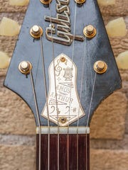 """Joe Bonamassa has borrowed a custom truss-rod cover, which Amos Arthur had custom made in the 1960s, for his 1958 Gibson Flying V guitar he has named """"Amos"""" to honor former Indianapolis music store owner who first sold the guitar in 1959."""