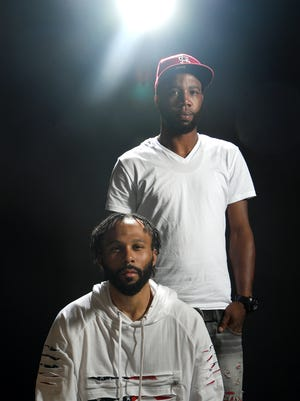 Brandon Pickens, left, and Marcus Hyatt, right, were pulled over by police for failure to use a turn signal when changing lanes in late January. Buncombe County Sheriff deputies detained the two men for four hours and strip searched them in a gas station bathroom looking for drugs.