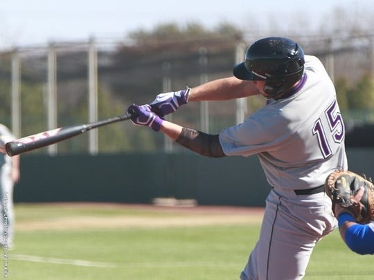 Kenneth Fudge, left, swings during a 2015 game against Lubbock Christian University while playing for New Mexico Highlands University.