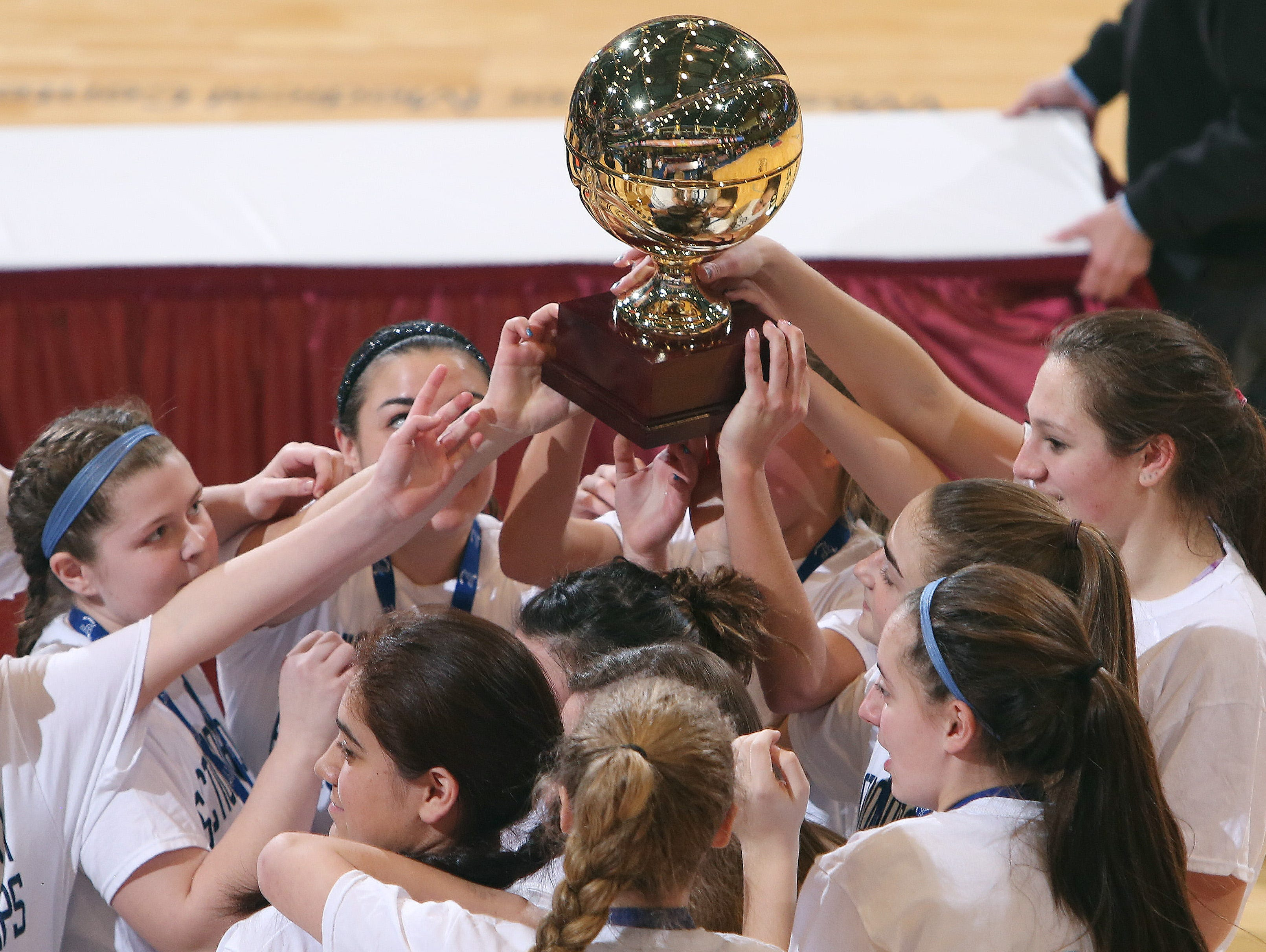 Haldane girls basketball players celebrate with the gold ball after defeating Hamilton 47-39 in the girls basketball Class C championship game at the Westchester County Center in White Plains March 4, 2017.
