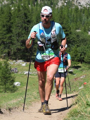 Chris Scarpitti climbs an uphill portion of the UTMB CCC ultramarathon in Europe.