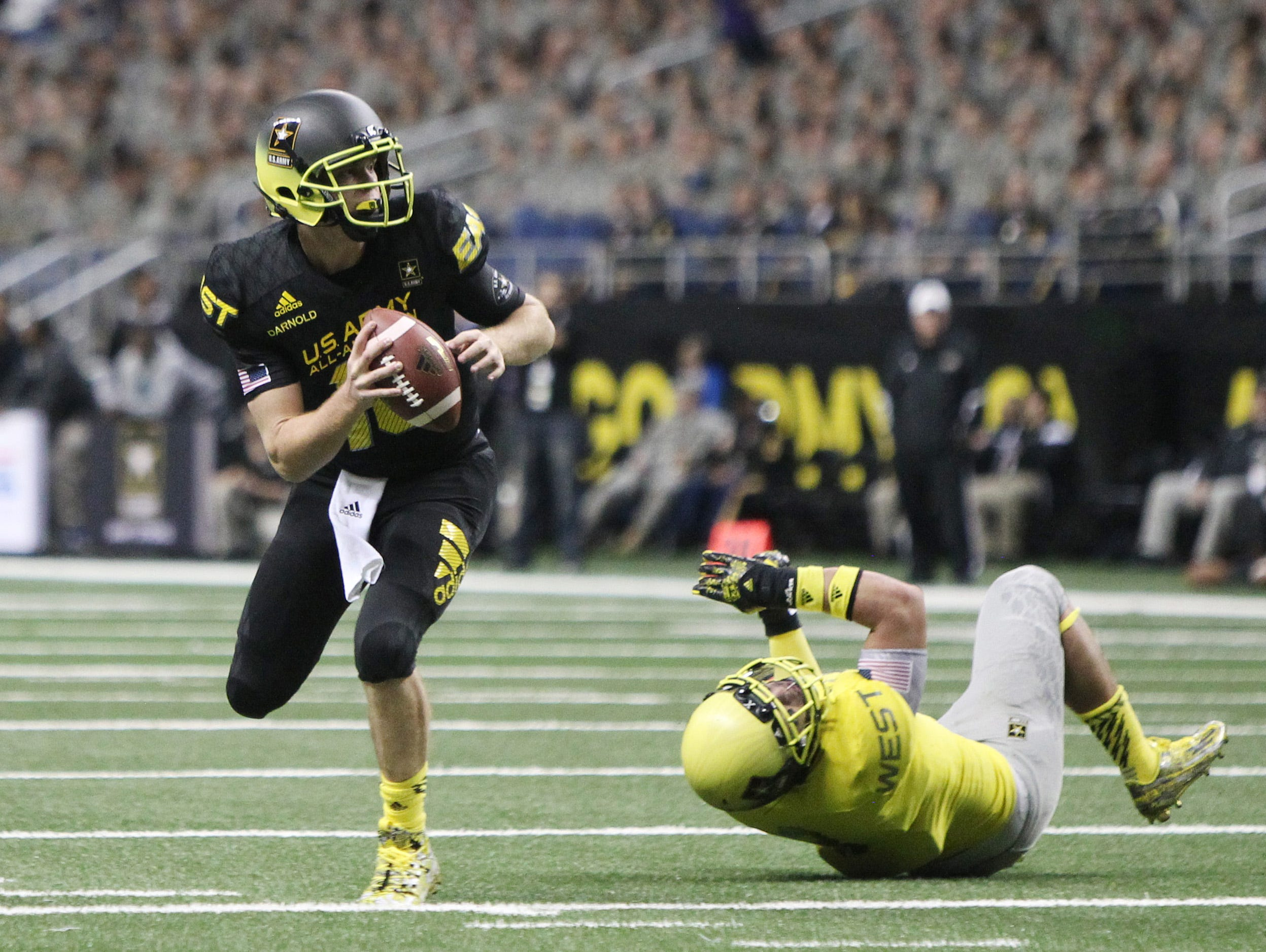 Jan 3, 2015; San Antonio, TX, USA; East quarterback Sam Darnold (18) gets away from West linebacker Osa Masina (3) in the U.S. Army All-American Bowl at the Alamodome. West beat East 39-36. Mandatory Credit: Erich Schlegel-USA TODAY Sports
